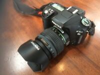Pentax K100D digital SLR camera including 18-55mm zoom lens and accessories