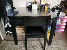 Black square dinning table with 4 chairs