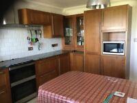 Kitchen cabinets and granite worktops.