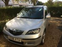 An 06 reg 2006 Mazda 2 Capella 1.4 petrol with the auto shift manual transmission.