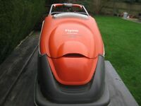 FLYMO TURBO COMPACT 380 LAWN MOWER IN GOOD WORKING ORDER COMPLETE WITH GRASS BUCKET AND LEAD.
