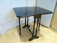 Very nice antique solid dark hard wood small folding leaf table