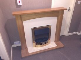 Electric fire and wooden oak finish surrounding!