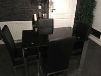 Black Glass Dinning Table & 4 chairs