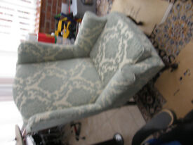 lovely high wing back arm chair, jade/green colour,hardy used, like brand new