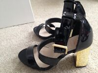 Patient black and gold heeled shoes, womens