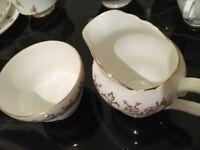 Milk jug and sugar bowl