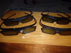 Samsung 4 pairs of 3D glasses model number SSG 5100GB, plus 8 spare batteries
