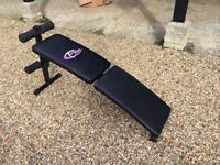 Foldable sit up bench and sit up exerciser
