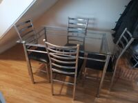 Glass top kitchen table and chairs