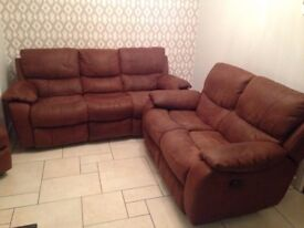 Reclining sofa. 2 x 3 seat Faux suede. Rarely used 2 years old.
