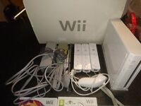 Nintendo Wii boxed with 3 remotes and games