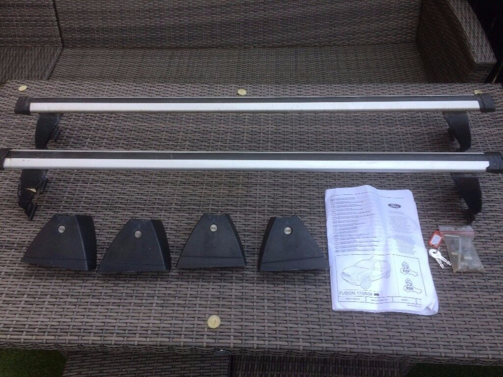 Genuine Ford Roof Bars with lockable covers and full instructions.