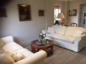 Two x Three Seater Sofas, cream loose covers in excellent condition, don't fit in our new home