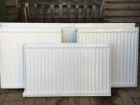 A range of used hot water radiators in good condition , white , single and double various sizes.