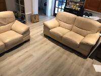 2 leather cream two seater sofas