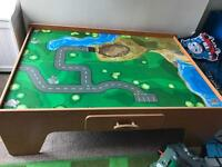 Train table and lots of thomas tracks