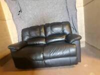 2 seater black leather reclining sofa
