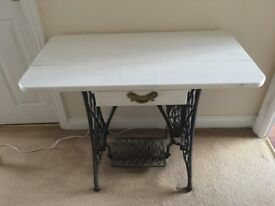 Side table made from vintage sewing machine. Painted chalk white with small drawer.