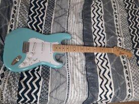 Guitar + spare strings