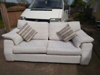 Immaculate three seater sofa in light grey