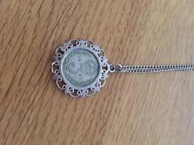 King George silver 3 pence mounted on a chain. 1921 .