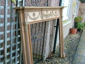 A stripped pine and gesso antique George III fire surround