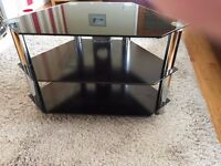 Black glass TV stand excellent condition from smoke free home . 31 W 18D 21H