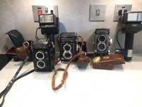 Vintage cameras 2 rolleiflex, 1 yashica and accessories