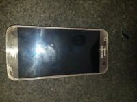 Workig phone few scratches and a little crack on back works fine gold coulor