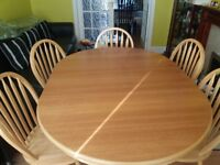 Extendable dining table and 6 chairs.
