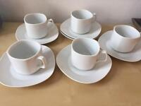 Nice simple set of 5 cups and saucers.