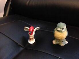 2 pretty small bird ornaments