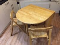 A solid John Lewis Butterfly Folding Dining Table and Four Chairs