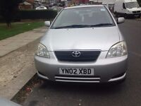 TOYOTA COROLLA 2002 MODEL, 5 DOOR, 1.6 ENGINE IS UP FOR SALE, WITH CUSTOM ALLOYS