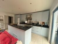 Used Kitchen with black granite worktop plus island