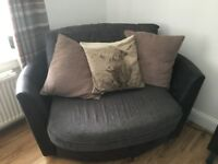 Small gray snuggle chair/sofa