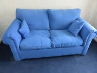 Blue double sofa bed with two cushions, good condition, £50
