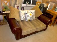 Two seater leather and fabric sofa