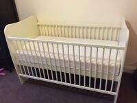 A lovely unisex white children's cot and bed in good condition with a mattress £40 ONO