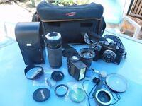 OLYMPUS OM2 Camera ,bag, tripod, lenses and filters