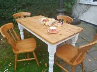 Beautiful upcycled solid table and four chairs