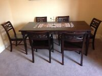 Beautiful solid wood 6 seater dining table and chairs