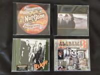 CDs. The Clash, U2, Alabama 3, Small Faces.