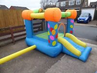 bouncy castle with slide compliments little tikes garden toys