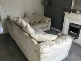 Corner sofa with scatter back cushions