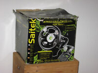 Saitek Adrenalin steering wheel, pedals and desk clamp for Xbox Original. In excellent condition.