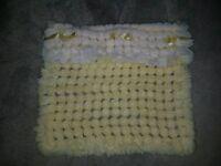 Reversible hand knitted pram cover