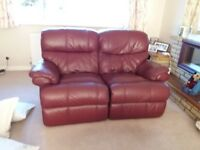 Two and three seater leather recliner settees.