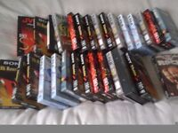 over thirty Sony, FUJI and JVC VHS tapes which have been used or are blank and three top movies -